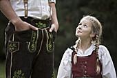 Girl wearing a dirndl, looking up, Kaufbeuren, Bavaria, Germany