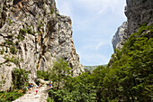 Hikers in a mountain scenery, Velika Paklenica, Paklenica National Park, Dalmatia, Croatia, Europe