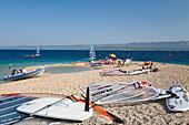 Sailboards lying on the beach in the sand, Golden Horn, Bol, Brac Island, Dalmatia, Croatia, Europe