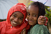 Happy children in the rain, Ambodifototra, Nosy St. Marie, Madagascar, Africa