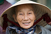 Friendly Vietnamese woman with traditional hat, Hue, Thua Thien-Hue, Vietnam