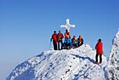 Alpinists photographing on summit of Rauhkopf, Bavarian foothills, Upper Bavaria, Bavaria, Germany