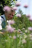 Farmer in bed of chives, biological dynamic (bio-dynamic) farming, Demeter, Lower Saxony, Germany