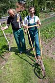 Farmer with cultivator, biological dynamic (bio-dynamic) farming, Demeter, Lower Saxony, Germany