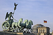 Quadriga on Brandenburg Gate, Berlin, Germany, Reichstag dome in background, Berlin, Germany