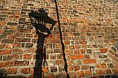 gas street light shadow on old bricks, Berlin