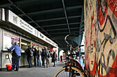 People standing in front of a snack under a bridge, Schönhäuser Allee, Berlin, Germany, Europe