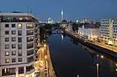 View over river Spress in the evening, television tower in background, Berlin, Germany