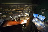 A woman at the central control room of the Berlin philharmonics during a concert, Berlin Germany, Europe