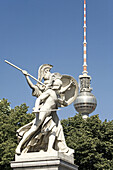 Sculptures of castle bridge, television tower in background, Berlin, Germany