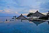 The infinity pool at the Amankila Resort in the evening, Candi Dasa, Eastern Bali, Indonesia, Asia