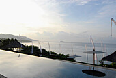 The infinity pool at the Amankila Resort in the morning, Candi Dasa, Eastern Bali, Indonesia, Asia