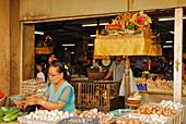Vendors at their stalls at the Central market Pasar Badung, Denpasar, Bali, Indonesia, Asia