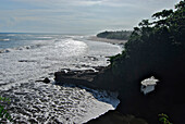 Rocky coast and surf in the sunlight, South Bali, Indonesia, Asia