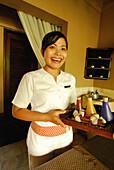 Laughing masseuse at the spa at Four Seasons Resort at Jimbaran, South Bali, Indonesia, Asia