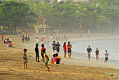 Local people at Kuta beach in the morning, Kuta, Bali, Indonesia, Asia