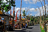 Feastfully decorated street under cloudy sky, Sidemen, East Bali, Indonesia, Asia