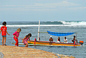 Children and boat on the beach of Sanur, South Bali, Indonesia, Asia
