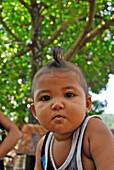 Portrait of a child at Tenganan, Bali Aga village, East Bali, Indonesia, Asia