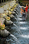 Locals in a water basin at Tirtha Empul temple, Central Bali, Indonesia, Asia