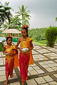 Girls wearing balinese costumes at the terrace of Amandari Resort, Yeh Agung valley, Bali, Indonesia, Asia