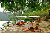 Sunloungers at the terrace next to the pool of the Amandari Resort, Yeh Agung valley, Bali, Indonesia, Asia