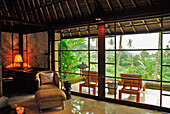 Interior view of a bungalow of the Amandari Resort with view at the terrace, Yeh Agung valley, Bali, Indonesia, Asia