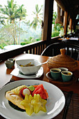 A table is laid at the window, breakfast at Amandari Resort, Yeh Agung, Bali, Indonesia, Asia