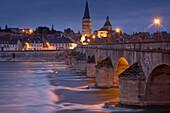 Evening in the old town of La-Charité-sur-Loire, Stone bridge over the Loire river, Church and former monastery Ste Croix Notre Dame, The Way of St. James, Chemins de Saint Jacques, Via Lemovicensis, La-Charité-sur-Loire, Dept. Nièvre, Burgundy, France, E