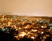 View from Barrio Xochimilco at the lights of Mexico City, Mexico, America