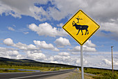 Caribou warning sign marker danger along Glenn Highway Alaska AK U S United States