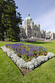 Flower Gardens in front of Parliament Buildings Legislative Assembly Victoria British Columbia BC Canada government law rules building neo-baroque design architect Francis Rattenbury