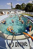 Senior citizens enjoying retirement in a resort swimming pool