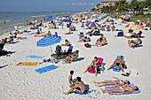 Visitors to Fort Myers Beach Florida enjoy sun and water