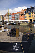 Ancient houses and boats at Nyhavn ('New Harbor'). Copenhagen. Denmark