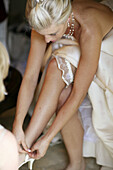 Arm, Arms, Blonde, Blondes, Bride, Brides, Caucasian, Caucasians, Color, Colour, Contemporary, Dress, Dresses, Evening gown, Evening gowns, Fair-haired, Female, Garter, Garters, Human, Indoor, Indoors, Interior, Jewel, Jewellery, Jewelry, Jewels, Lace-up