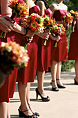 Bouquet, Bouquets, Bridesmaid, Bridesmaids, Color, Colour, Contemporary, Daytime, Evening gown, Evening gowns, Exterior, Female, Headless, Human, Many, Marriage, Matrimony, Outdoor, Outdoors, Outside, People, Person, Persons, Red, Wedding, Weddings, Woman
