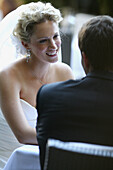 Back view, Bridal couple, Bride, Bridegroom, Bridegrooms, Brides, Color, Colour, Contemporary, Daytime, Dress, Dresses, Exterior, Grin, Grinning, Groom, Grooms, Happiness, Happy, Head & shoulders, Head and shoulders, Joy, Love, Outdoor, Outdoors, Outside,