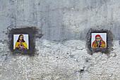 Tiles with images of Jesus Christ and Shirdi Sai Baba on the external wall of a residential condominium in Santacruz district, Mumbai, Maharashtra, India