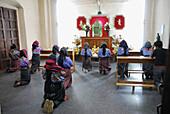 Women praying, Santiago Atitlan. Guatemala