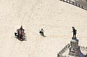 Touring cyclists at Tartini Square, Piran, Slovenia, Balkans, Europe