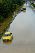Inundation of highway after heavy rainfall, abandones cars after evacuation of vehicle occupants, highway Frankenschnellweg near Baiersdorf and Erlangen, Franconia, Bavaria, Germany