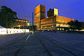 Oslo Town Hall, seen from Aker Brygge with tram lines in the foreground, Oslo, Norway
