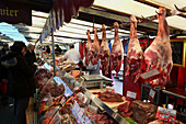 A meat stall in weekend food market. Paris. France