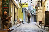 Antique furniture restoration shops line up Passage du Chantier. Paris. France