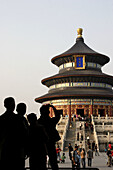 Visitors taking photos of Qinian Hall (Hall of Prayer for good harvest) of Temple of Heaven. Beijing. China
