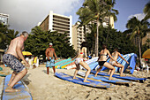 Students of a surfing school practices their skill on Waikiki Beach. Oahu Island. Hawaii. USA