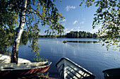 Birch trees and boats at the shore of the Päijanne lake, Jyväskylä, Finland, Europe