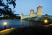 The Olavinlinna castle at Savonlinna lake in the evening, Karelia, Finland, Europe