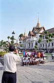 Teacher taking a photo of a school class, Grand Palace, Bangkok, Thailand